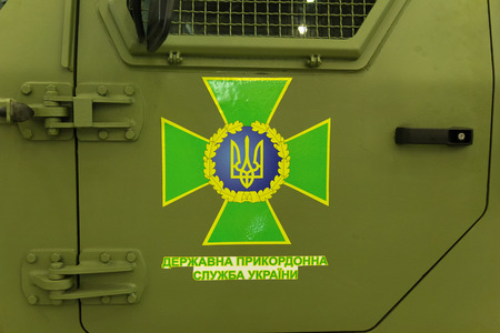 armored car: Emblem of the State Border Service of Ukraine on the door of an armored car