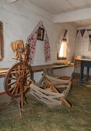 pirogovo: Distaff and utensils in ancient peasant hut. Pirogovo, Ukraine