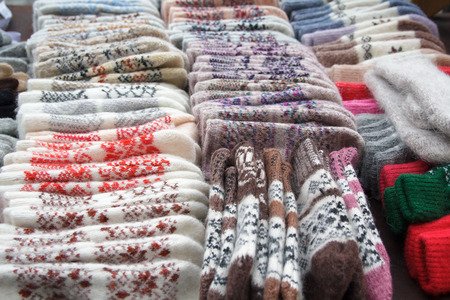 soft sell: Wool warm mittens on the counter. Winter