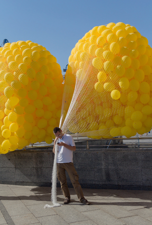 high day: Kiev, Ukraine - September 20, 2015: Man holding balloons before running at the event celebrating the Fathers Day Editorial