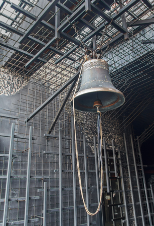 genocide: Bell on a background of a metal cage. The memorial complex to the victims of Holodomor in Ukraine in 1932-1933. Kiev
