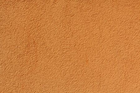 stucco house: Orange stucco relief on the wall of the house. Backgrounds and textures Stock Photo