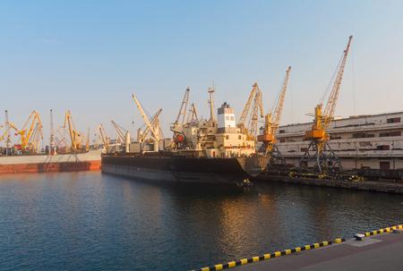 unloading: Cargo ships unloading at the port terminal. Odessa, Ukraine Stock Photo