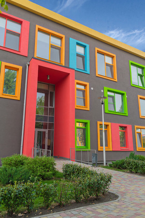 house facades: Multi-colored windows of the school in a contemporary style. Architecture Stock Photo
