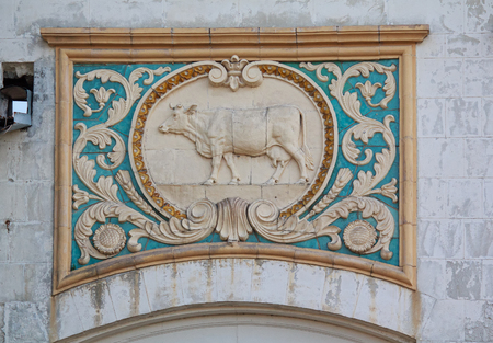 relievo: Bas-relief of the Soviet era in the building of the livestock pavilion. Kiev, Ukraine