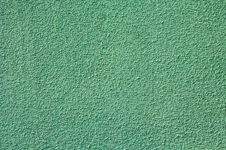 stucco house: Green stucco relief on the wall of the house. Backgrounds and textures