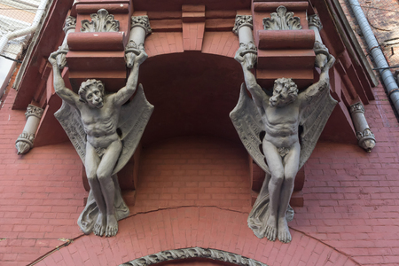 pilasters: Sculptures demon with wings on wall of house in Kiev. Ukraine