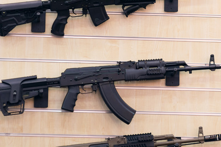 ak 74: Stand with automatic rifle. Weapon and self-defense Stock Photo