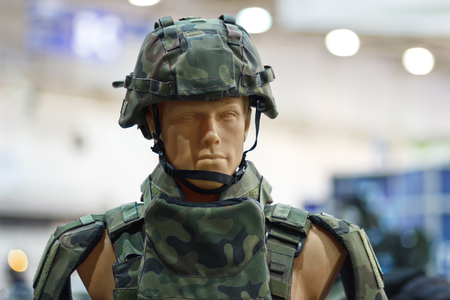 defense facilities: Mannequin in an army helmet and bulletproof vest Stock Photo
