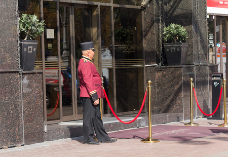 Kiev, Ukraine - September 18, 2015: Doorman in uniform at work in the street Khreshchatyk
