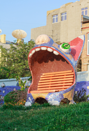 constantin: Kiev, Ukraine - Septwmber 09, 2015: Sculptured bench of funny cat with opened mouth by the sculptor Constantin Skretutsky at Pejzazhna alley