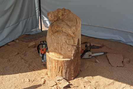 mastery: Blanks for wooden sculptures, sawdust and chainsaw. Mastery Stock Photo