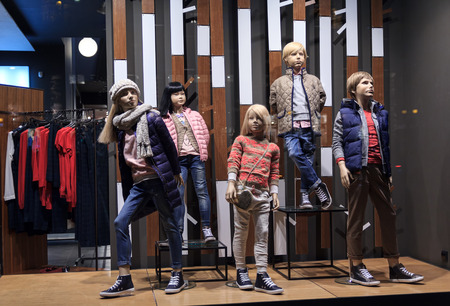 clothing stores: Children mannequins in warm clothes in the shop window. Sale Stock Photo