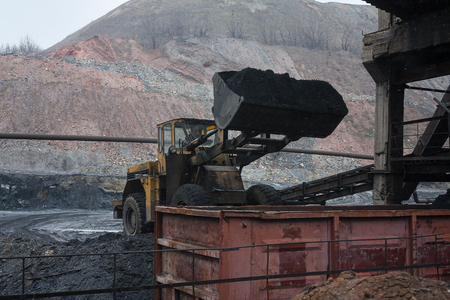 loader: Loader loads coal into rail car. Industry