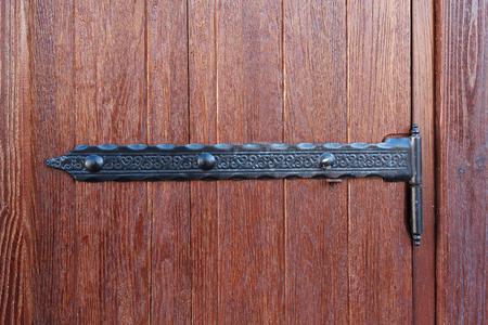 metal textures: Wooden doors and vintage metal hinges. Backgrounds and textures