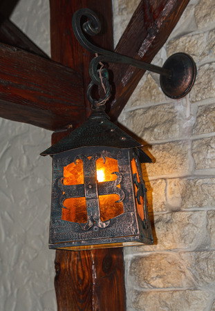 scintillating: Vintage lantern in the interior of a cafe. Interior and lighting