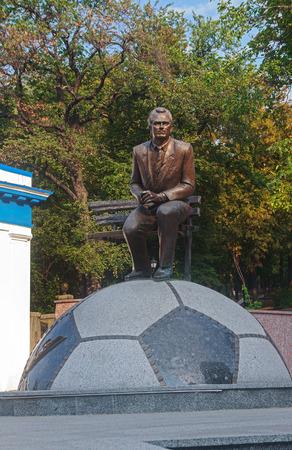 dynamo: Kiev, Ukraine - September 03, 2015: Monument to the unknown football coach Valery Lobanovsky at the entrance to the Dynamo stadium Editorial