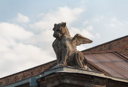 guard house: Sculpture of a winged lion on the roof of the building. Kiev, Ukraine