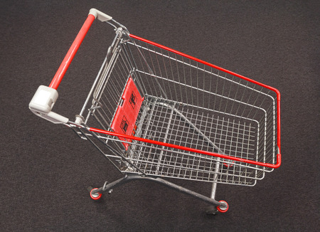 pushcart: Shopping cart on a gray carpet top view Stock Photo