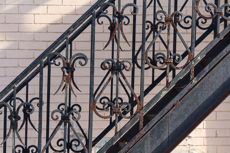 Rusty vintage black forged metal fence. Architecture