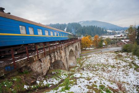 diesel train: Diesel train traveling on the viaduct. Vorokhta, Ukraine Stock Photo