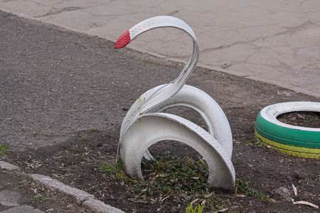 schoolyard: Swan made of automobile tires in the schoolyard Stock Photo