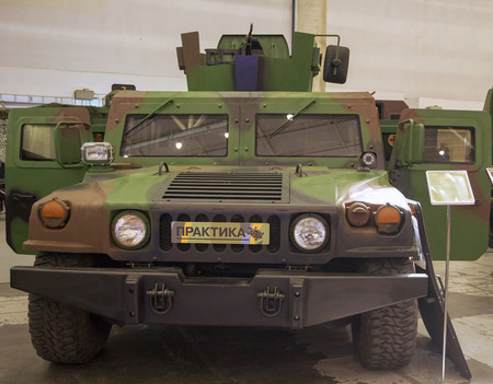 adapted: Kiev, Ukraine - September 22, 2015: Car Hummer adapted to the needs of the Ukrainian army at the specialized exhibition Arms and Security - 2015