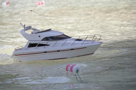 Model boat floats in the pool. Ship modeling