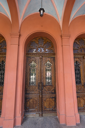 Old wooden door of the Christian church. Architecture