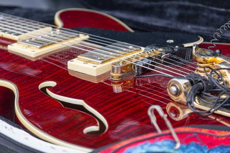 Neck electric guitar in a case close-up. Music