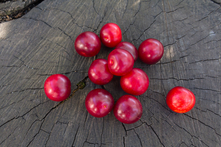 Ripe plums on a wooden surface. Fruit
