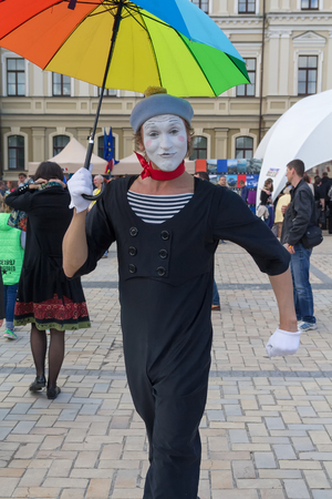 entertaining area: Kiev, Ukraine - May 21, 2016: Actor in the role of mime entertains residents during the celebration of Europe Day