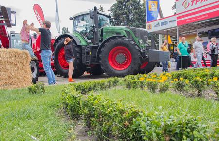 agro: Ukraine, Kiev - June 10, 2016: Visitors near the exhibits International agro-industrial exhibition AGRO 2016