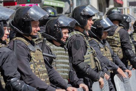 gay parade: Kiev, Ukraine - June 12, 2016: Cordon of police wearing armor while protecting gay parade