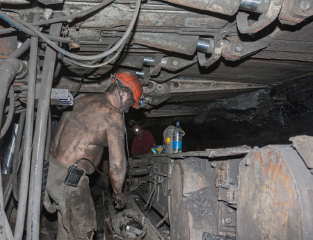 shearer: Miners near a coal-plow machine in the underground workings. industry