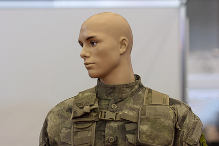 defense facilities: Mannequin in camouflage uniforms infantryman closeup. Weaponry