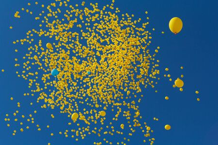 Flies in the sky yellow balls. Abstract background Stock Photo