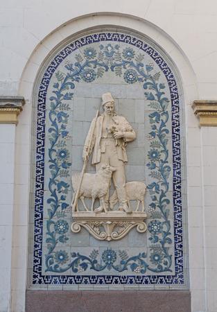 relievo: Bas-relief of the Soviet era in the building of the pavilion ENEA. Kiev, Ukraine Stock Photo