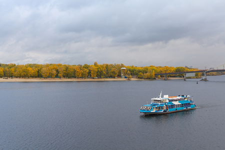 dnepr: Tourist pleasure boats on the Dnepr River and river shore autumn. Kiev. Ukraine Stock Photo