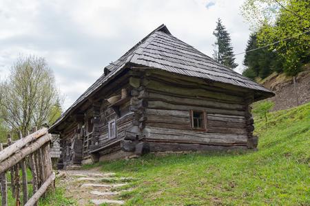 lopsided: Ancient wooden house Ukrainian peasant. Kolochava, Ukraine