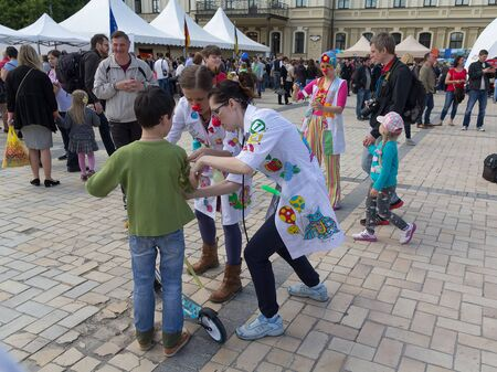 entertain: Kiev, Ukraine - May 21, 2016: Actors in the role of clowns to entertain children during the celebration of Europe Day Editorial