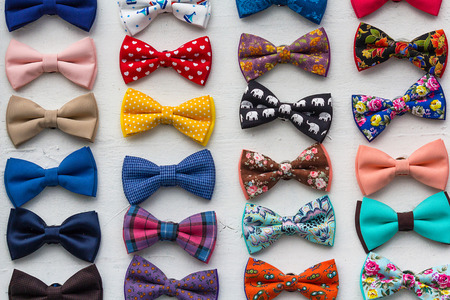 ?olorful bow ties are located in the window. Styles 免版税图像
