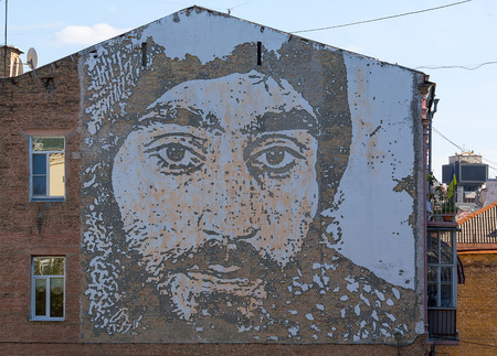 pseudonym: Kiev, Ukraine - September 11, 2015: Portrait of a Hero Heavenly hundred Sergei Nigoyan on the wall of a house made the artist known by the pseudonym Vhils