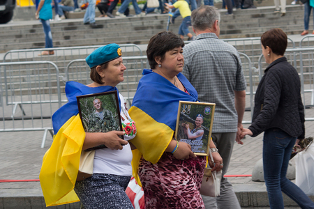 antiterrorist: Kiev, Ukraine - August 24, 2016: Mothers with pictures of those killed in the zone of the antiterrorist operation soldiers after the parade on Independence Square