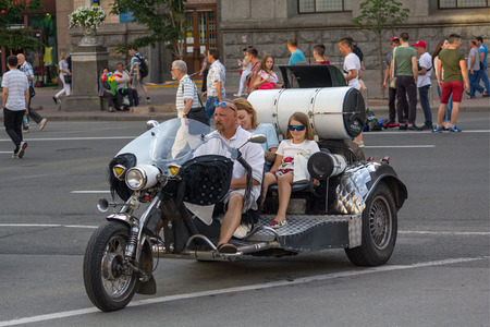 carting: Kiev, Ukraine - June 19, 2016: Mother and daughter ride on a motorcycle in the output on Khreschatyk Street Editorial