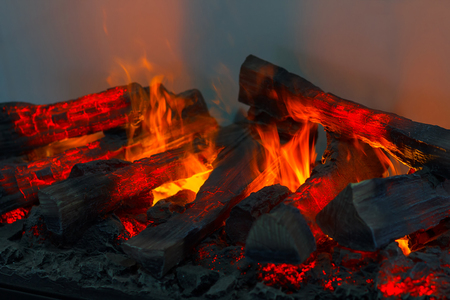smolder: Wood burning in the fireplace closeup. Home