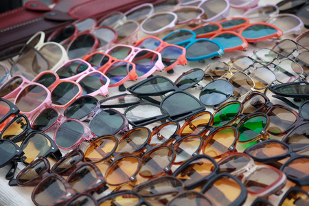 Sunglasses in the range lie on the counter. Sale
