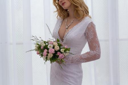 顔のない花とドレスの花嫁 写真素材