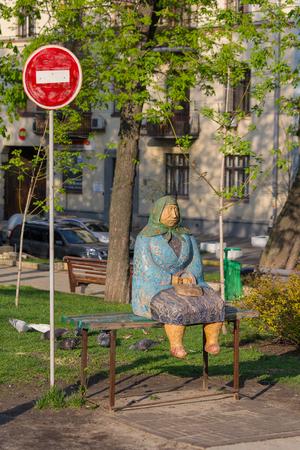 80th: Kiev, Ukraine - April 14, 2016: Monument called Classical grandmother in the Shevchenko Park a symbol of Kiev grandmas of 80th Editorial