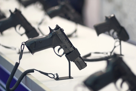Different pistols models on store shelves. Weapon Stock Photo